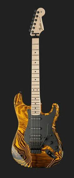 Une Fender Stratocaster finition Yellow Swirl FSR. Retrouvez des cours de guitare d'un nouveau genre sur MyMusicTeacher.fr