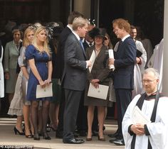 Lady Kitty Spencer, in dark blue dress, with her father, Charles, Earl Spencer, and her aunt, Lady Sarah McCorquodale speak with Prince Harry and Prince William (nearly blocked out by Prince Harry) at a church service to commemorate the life of Princess Diana, 2008.