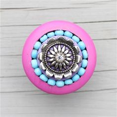 Pink Furniture Knobs with Crystal and Turquoise Beads CUSTOM design Available If you are looking for beautiful furniture knobs specifically designed to match your home decor, then these are perfect for you! Choose your own paint, beads, crystals, and metal centerpieces to complement your color scheme! This particular gorgeous knob features bright fuchsia pink paint with a purple center and turquoise beads. These cabinet knobs are sure to add interest to any space!