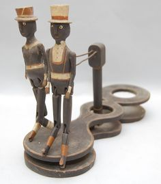 19TH-EARLY 20TH CENT. CARVED & PAINTED BLACK FOLK ART TOY
