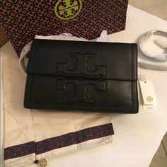"""NWT TORY BURCH Handbag  New with tag. 100% Authentic. Color Black Leather. With dust bag and shopping bag. Adjustable removable strap. Can be use a cross body. Dimension: 12""""L x 3""""W x 8""""H. Tory Burch Bags"""