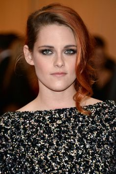A newly auburn-hued up-do with face-framing curls for the Met Ball in New York.