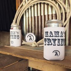 """Mama's Trying Koozie - Keep your beverage cold in style! """"Mama's Trying"""" and 7s on one side. Our kind of feels from the classic Mama Tried lyrics. 7s Bottom."""