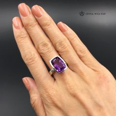 """This modern genuine Amethyst ring is a crystallized dream come true! Feel like a fairytale princess every time you wear this faceted beauty.  This rectangular cushion cut statement ring is set in sterling silver and has gorgeous clarity, sparkle and deep color. Makes a perfect everyday ring or a treasure to showcase during special occasions.   Available Sizes: Ring Size: 9.5 Crystal Size: 15mm x 12mm (0.59"""" x 0.47"""")   Ring Size: 5.5 Crystal Size: 16mm x 12mm (0.63"""" x 0.47"""")"""