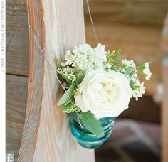 antique aqua insulators turned into flower vases hanging from a church pew...ooooh, I need to do this!  :)