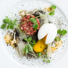 Wagyu Steak Tartare with Soft-Boiled Egg, Black Breadcrumbs, and Pickled Watermelon Rind