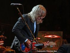 Davey Johnstone playing the Mandolisa , Elton John Band. Painted by Traci Loving