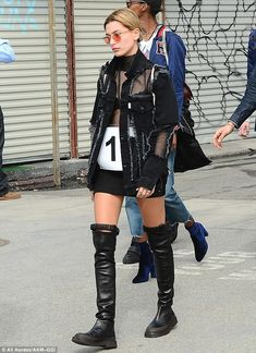 Hailey Baldwin in an amazing pair of knee high boots.