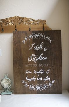 Beautiful hand painted wedding welcome sign on dark stained plywood.  Love, laughter & happily ever after. Home keepsake after the event.