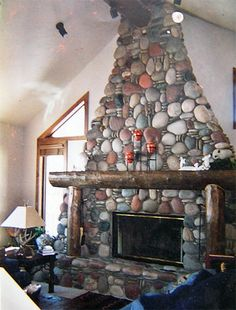 River rock flats and coins compliment this rough and tumble mountain fireplace. Cottage Fireplace, Fireplace Mantle, Zero Clearance Fireplace, Woodsy Decor, River Rock Fireplaces, Fireplace Remodel, Fireplace Inserts, Log Homes, House Rooms
