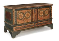 Sold For $24,000                                                          Berks County, Pennsylvania painted dower chest, dated 1789, attributed to Beiber, inscribed Catharina Reichner, the front decorated with two large hearts flanked by tulip vines on a red and yellow stippled surface, above two long drawers and straight bracket feet, inscribed inside the till drawer Jacob Reichner 1788 Oley, 29'' h., 47'' w.