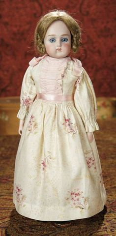"15""-German Bisque Doll, Model 914, by Alt, Beck and Gottschalk~~~Marks: 914 # (crown rim). Comments: Alt, Beck and Gottschalk, circa 1885. Value Points: rarer model with wide-eyed expression, original sturdy body, pretty antique costume and leather shoes."