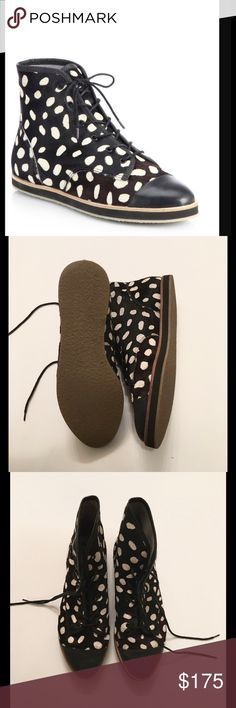 Spotted High Top Sneaker spotted calf hair high-top with a leather toe cap. Like new! No box included. Loeffler Randall Shoes Sneakers