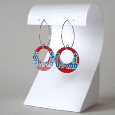 These eco-chic red and blue earrings were hand-cut from a vintage tea tin, available in my storenvy shop