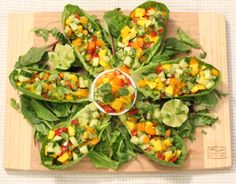 FRUIT SALSA BOATS- mango, kiwi type fruit mixed with grape tomatoes, cucumber, avocado, bell pepper, seasoned w/cilantro lime, served in Artisan Romaine leaves