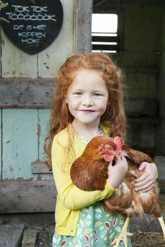 Country Kids / ginger girl with chicken