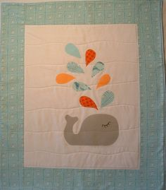 baby blanket, fleece stroller blanket, crib quilt, play make, nursery decor, kids wall art, whale with blue and orange spout. $68.00, via Etsy.