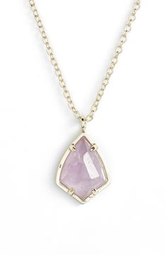 This stunning amethyst and gold necklace would make for a cute accessory on the bridesmaids.