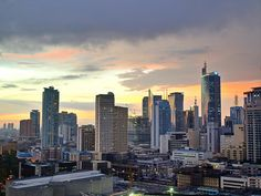 Solid-Faced Canvas Print Wall Art Print entitled The sun setting light up low clouds over the Makati City, Manila Skyline. Philippines Tourism, Les Philippines, Makati City, Quezon City, Davao, Cebu, Iloilo, Places To Travel, Places To See