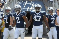 Penn State players. I get chills every time I see football boys hold hands on the field. <3