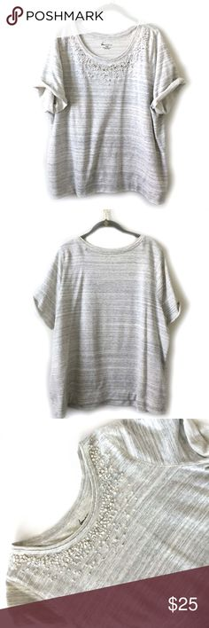 """Lane Bryant SS Grey/Cream Sweatshirt w/ faux jewel Lane Bryant SS Grey and Cream Sweatshirt with faux rhinestone and faux pearl  neckline. RN#118641 S 1041066. Neckline has unfinished appearance. Sleeves are also unfinished and are rolled -  stitching on top of sleeves to hold up roll has been removed- see photo.  Size 18/20 Approx. Measurements: Bust 25.5"""" Length 28"""" - both taken with item laying flat. Materials 70% Cotton, 30% Polyester- Machine wash. Great condition- no holes or stains…"""