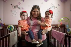 Lindsay Salgueiro poses for a photograph with her twin girls, Sophia Rodriguez, left, and Gabriela Rodriguez. Sophia was born on Jan. 1, 2014, and Gabriela was born on Dec. 31, 2013.