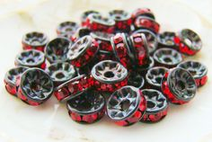 Holiday Sparkle 7mm Black Patina Ruby Red Rhinestone Rondelle Spacer Beads by alyssabethsvintage on Etsy