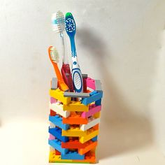 In case you can't find the gift you want, make it out of legos. LEGO Toothbrush Holder #etsy