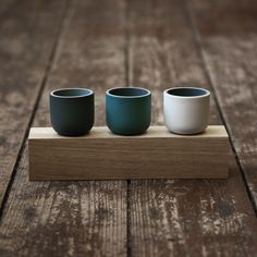 Image of Mini Row on Wood - Porcelain Vessels by Jill Shaddock. Photo by Ed Chadwick.