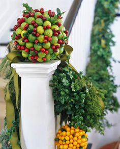 Floral designer John R. Roberts achieves this look by pinning limes and cranberries to a foam ball - Traditional Home®