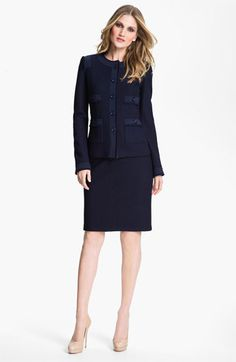 "This is the ""power suit"" for this profile.  A navy blue with top embellishments and a strong shoulder.  Pass on a necklace, but add a shiny earring and a printed handbag for interest and a finished look. If needed, tailor so the waist cinches, creating an hourglass shape. St. John Collection Bouclé Jacket & Dress 