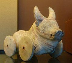 Toy buffalo on wheels. Terracotta, Magna Graecia, Archaic Age.