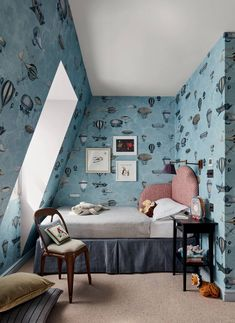 In this attic bedroom, the wallpaper is Fornasetti's 'Macchine Volanti' from Cole & Son. Cosy Reading Corner, Bed In Corner, Tongue And Groove Panelling, Mad About The House, Monday Inspiration, London House, Cole And Son, Decoration, Home And Family