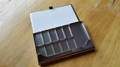 Travel sketchbook Watercolor paint palette with magnetic removable pans business card size. Only weighs only 2.9 oz. Pocket size! 2x4 inches