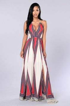 - Available in Ivory - Printed Maxi Dress - Halter Rope Tie - Open Back with Tie - Two Side Slits - 100% Rayon