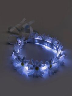 LED Glow Daisy Crown | Dance the night away in this American made soft flower crown, featuring daisy fabric blooms and battery-operated LED lights to make you shine bright. Grosgrain ribbon ties for a versatile, effortless wear. Replaceable batteries last for approximately 20 hours.