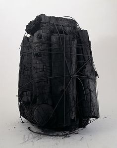 "LEE BAE, UNTITLED 2000: ""huge chunks of charcoal are bound in elastic string…"