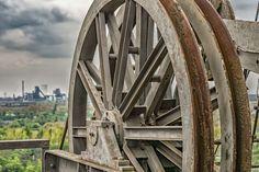 #abandoned #architecture #dark clouds #dirty #equipment #industrial #industrial plant #industry #iron #landmark #machine #machinery #metal #outdoors #power #rust #rusty #spokes #steel #travel #turn #vehicle #wheel
