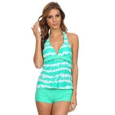 Hit the beach in style with this darling mint and white pattern tankini swimsuit. The stylish halter top ties around the neck and the ensemble is completed by matching mint boyshorts.