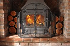 Mayfair Fire Screen - This Mayfair Fire Screen will bring a luxurious touch to any fire, the fleur de lys detail gives an elegant traditional feel to a room. It is a high quality product, with a black finish.