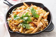 Do you need more easy weeknight dinner recipes for families? This One Pot Sun-Dried Tomato Chicken Bacon Pasta is just what you're looking for! The dish is made with lean chicken breasts, penne pasta, dried tomatoes, bacon, garlic, broth and milk. The creamy sauce has no cream at all, so this is the perfect healthy meal idea. Click through now to learn how to make this comfort food meal!