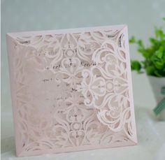 Blush Laser Cut Wedding Invitation from elegantweddinginvites.com
