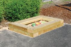 An attractive and robust sleeper edged sandpit with a solid lid; an ever popular playground classic.