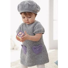 Sweet dress with accent heart pockets and matching beret for ages 6 to 18 months. (Patons Yarns)