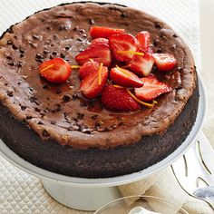 This chocolate cheesecake recipe is made even more delicious with added coffee flavoring and strawberries to top it all off! This dessert is certainly easy and quick with only a 35 minute of prep to make a great party dessert or a Valentine's Day treat for your sweetie!