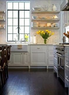 open shelving, bright windows & dark stained flooring....I love this kitchen :)