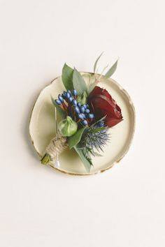 Winter boutonniere | Sweet Events Photography | see more on: http://burnettsboards.com/2015/01/lavish-rustic-midwinter-wedding/