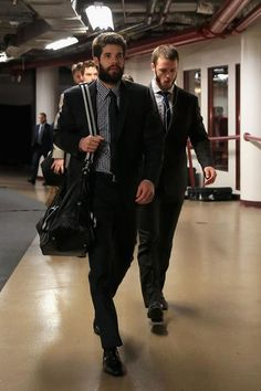 CHICAGO, IL - JUNE 22:  (L-R) Goalie Corey Crawford #50 and Jonathan Toews #19 of the Chicago Blackhawks arrive at the arena to play against the Boston Bruins in Game Five of the 2013 NHL Stanley Cup Final at United Center on June 22, 2013 in Chicago, Illinois.  (Photo by Bruce Bennett/Getty Images)