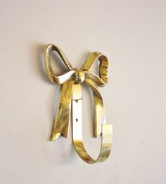 Large vintage brass bow wall hook. $22.00, via Etsy.