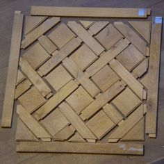 Parquet de Versailles is a style of hardwood flooring that prevails at the Chateau de Versailles. This illustrates how the elements, characteristically oak, fit together to form a basket-weave pattern about a meter square. Jeff